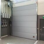 insulated compact sectional door in refrigerated warehouse