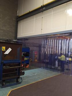 Stripdoor within flexwall partitioning