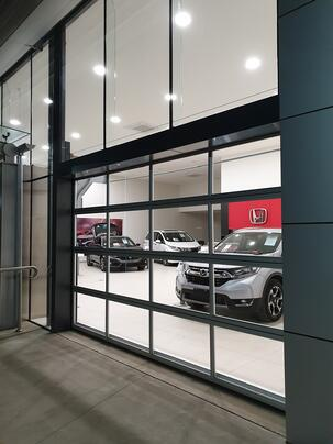 Architect designed sectional doors to match the design of the car showroom