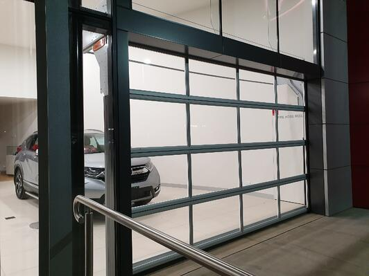 glass sectional doors bespoke to the car showroom sector