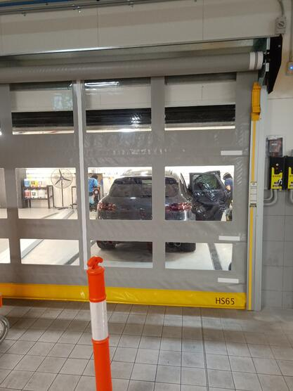 Remax Movidor rapid roller door installed in luxury car dealership washdown bay and service area