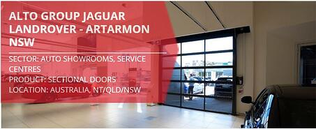 Remax installation of Compact sectional doors in car showroom at Jaguar Landrover