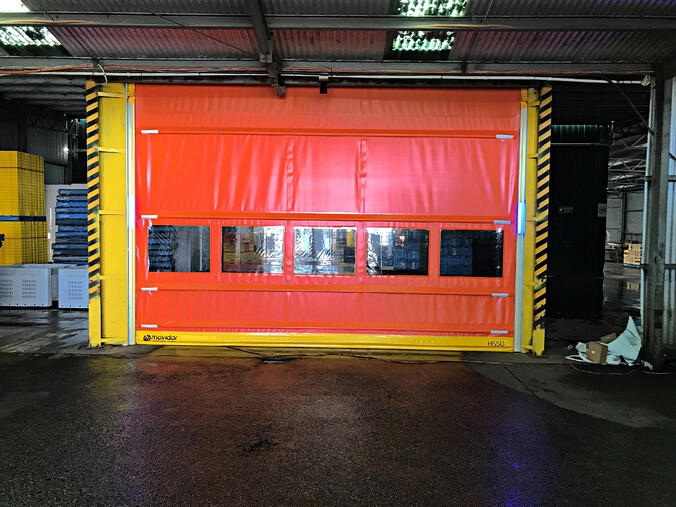 Warehouse doors at a farm improving access with high speed doors