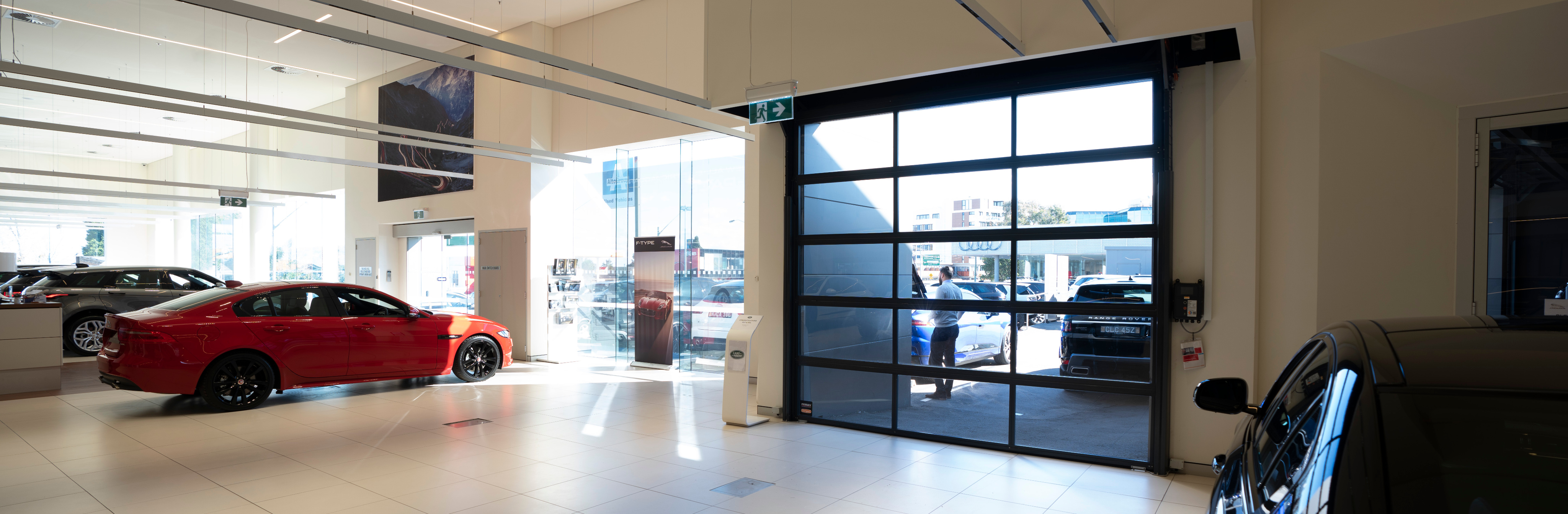 Remax installed glass Sectional Door in a car showroom